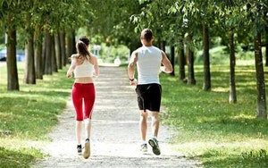 Couple running on a jogging track